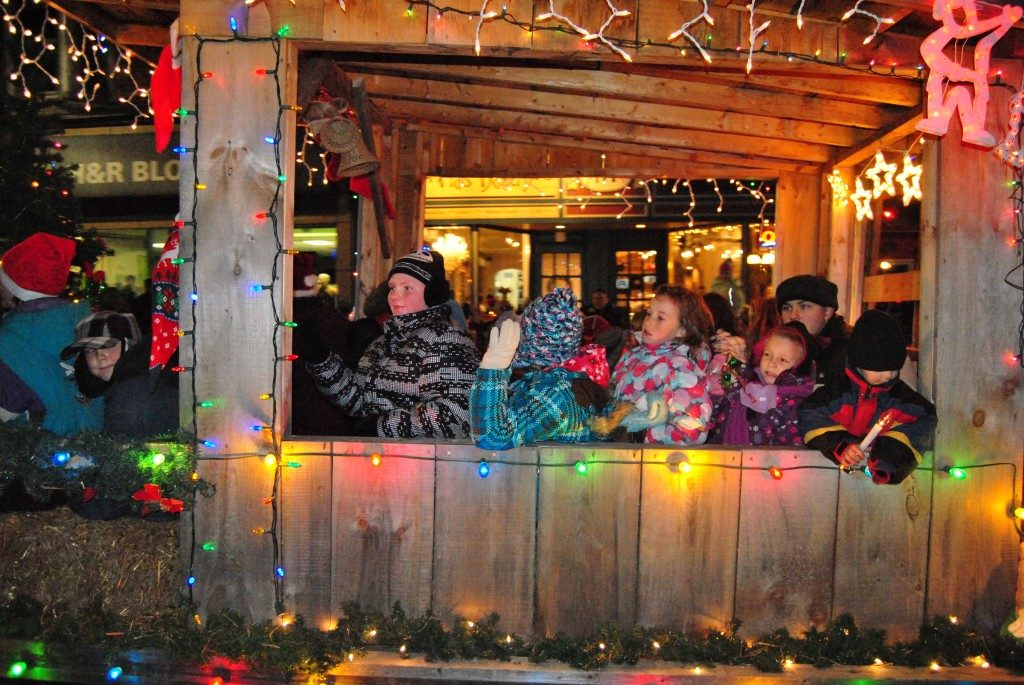 Kids riding holiday float pulled by tractor at Orangeville Moonlight Magic